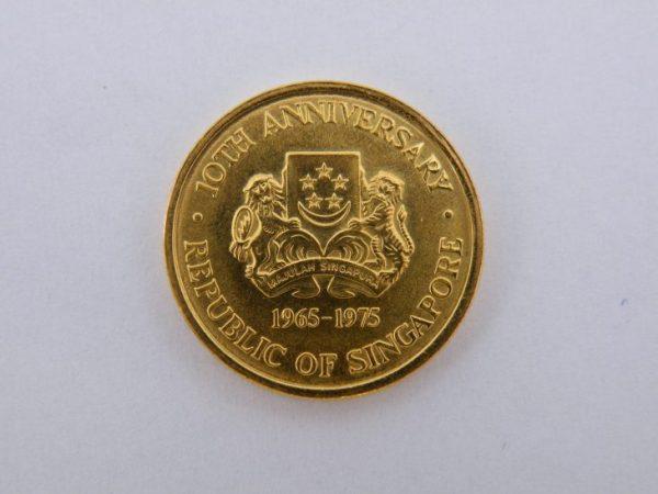 100 dollars Singapore goud
